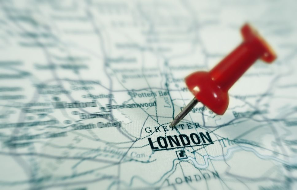 closeup of a map with London with red pin