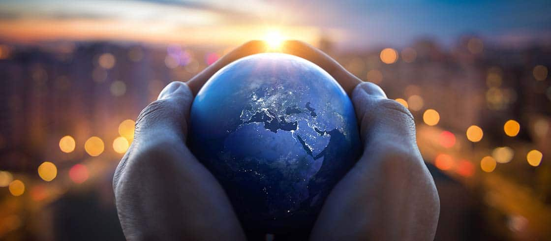 The globe Earth in the hands of man against the night city. Concept on business, politics, ecology and media. Earth day abstract background. Elements of this image furnished by NASA.